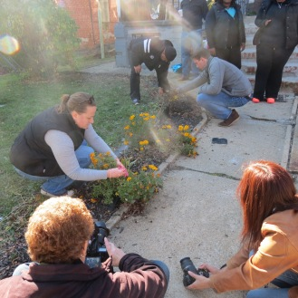 Along with building the fence, volunteers also planted new flowers along the front path to beautify the home.