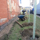 Once the holes were dug, the posts could be placed for the base of the fence.