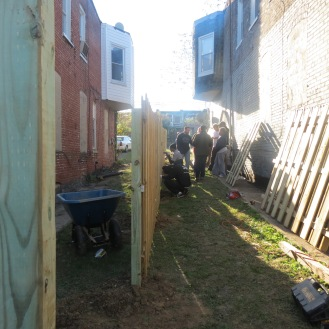 Volunteers working on getting the fence up and into place.