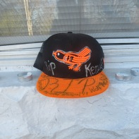 Orioles and Ravens hats were decorated in memory of Fenwick and placed along his porch.